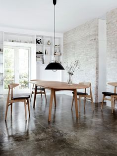 concrete floor + wegner chairs!