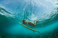 Rosy Hodge doing a duck dive in the Maldives #DAREYOURSELF