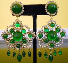 """Kenneth Jay Lane green cabochon """"Flamenco"""" earrings from twisted-vintage-textiles.com  One of his most popular styles! 1960s green cabochon and rhinestone """"Flamenco"""" clip earrings, signed K.J.L."""