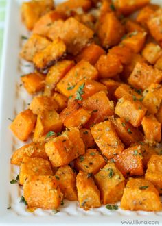 Baked Parmesan Sweet Potatoes - my new favorite side dish recipe. Takes minutes to make and tastes AMAZING!! Soft sweet potatoes coated with parmesan cheese and all kinds of spices!!