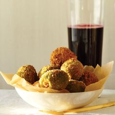 A new take on a classic nosh: These olives are stuffed with creamy blue cheese and fried.