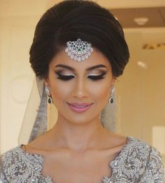That dress your face stunning eye - A perfect smokey topped with a white/silver wing <3 - perfect look for The Indian bride's Engagement | suggested by Neha Makeup Artistry for WIttyVows