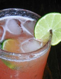 Barbados Rum Punch (2 1/2 cups guava nectar 2 1/2 cups pineapple juice 1 1/2 cups rum  1/4 cup lime juice 1/2 large pink grapefruit, juice of)