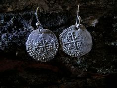 One or two of these was about equivalent to a days wage for a sailor. This type is dated to 1652, in what is known as the 'buccaneering age' of the Caribbean.  Sterling silver earring hooks, pure silver coins. Each is minted traditionally by hand.
