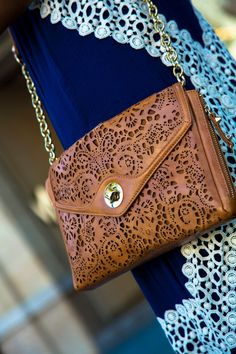 the Sole Society Janie laser cut clutch in color luggage.