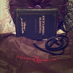 NWOT Salvador Bachiller Encyclopedia Bag NWOT, authentic and comes with dust bag and removable shoulder/crossbody strap. Leather and styled like an encyclopedia book. Purchased from the flagship SB boutique in Madrid, Spain. Salvador Bachiller Bags