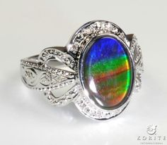 I really want this Ammolite ring!