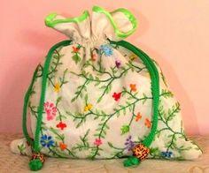 An off-white elegant silk hand embroidered batua bag from Dream Catchers Studio. Kolkata. Contact-+918017191730