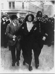 British police arresting a suffragette for protesting in favor of her right to vote, 1913.