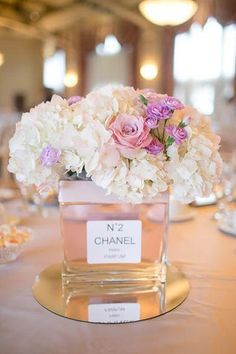Love this fabulous centerpiece for the Chanel loving bride!