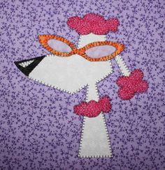 Poodle applique wall hanging.  Dog quilt.
