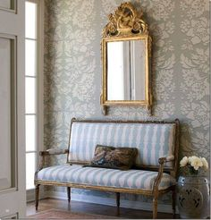 Beautiful gilt wood French Settee upholstered in shades of baby blue stripes.