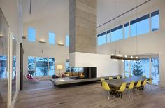 the open space and the fireplace that starts to define the rooms. I like it