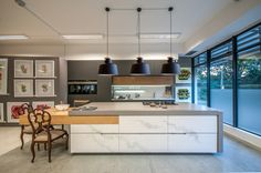For those of us who love preparing meals & entertaining, the kitchen is the heart of the home. Hanging 3 pendants over your island can create character & add to the overall look & feel of your kitchen!