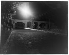 "Pacific Electric Railroad Bridge, 1913,  IRVING GILL, ARCHITECT ""Sodium Vapor Lights, Torrance,"" photo by G Haven Bishop, 1937 as seen in the on-line exhibit FORM and LANDSCAPE"