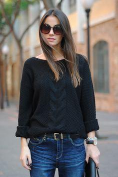black sweater. oversized round shades