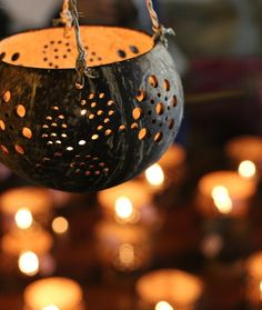 Hand-carved coconut votives light up Chiang Mai's night market.
