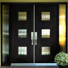 Contemporary Double Door with Glass & Sidelites This custom door revels in mid-century retro style. The geometric glass design and black finish combine create a stunning contemporary effect.