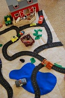 play mat with roads for driving cars. And you can collaborate with other toys making a 3D tiny world