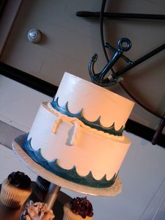 Nautical Wedding Cake by Cakes by Look. Ribbon instead of waves but like the rope