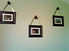 I used wooden curtain rod finials (from Lowes) as picture hangers. Just attach ribbon to back of frame and hang! Fraction of the price of the pottery barn hangers...but looks the same!!