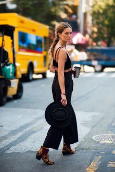 Erin Wasson. Black crop top and high waisted, over sized, black overalls.