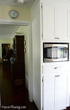 They built this cabinet to hold the microwave and pull out trashcan underneath.