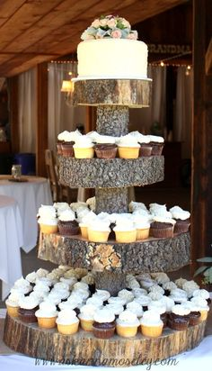 tree stump cake stand...this is exactly what we want!!!! Though maybe not quite as thick pieces of wood. And we're thinking 2 tiers on top. Though, now I'm thinking (since I looooooove that yellow and teal cake) that we'll just do a tower of cupcakes like this and then have a 2 or 3 tierd cake like the yellow one.
