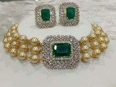 Royalty redefined with this choker neckpiece of south sea pearls, emeralds and diamonds