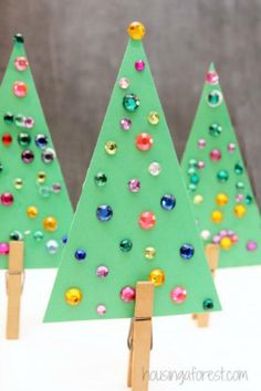 Easy Christmas Tree Crafts Ideas for toddlers and preschoole.- Easy Christmas Tree Crafts Ideas for toddlers and preschoolers Jeweled Christmas tree - Jeweled Christmas Trees, Christmas Tree Crafts, Christmas Holidays, Christmas Ornaments, Christmas Crafts For Preschoolers, Kids Winter Crafts, Christmas Crafts For Kids To Make Toddlers, Christmas Projects For Kids, Kindergarten Christmas Crafts
