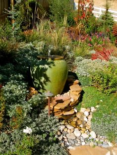eclectic landscape by Life Design concept - drought tolerant plants and a dry creek bed/water feature