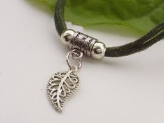 Cute silver tone filigree leaf cord charm bracelet, with the silver tone charm set on a double strand of dark green suede cord bracelet. The charm has a nice bright silver feel to it, making it perfect as a gift or simply a little treat for yourself. Blue Forest, Green Suede, Cord Bracelets, Leaves, Charmed, Autumn, Dark, Silver, Gifts