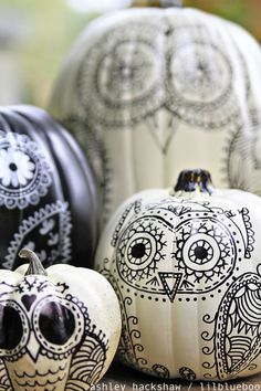 "A cute idea for decorating a pumpkin without carving it: draw these ""sugar skull"" owls on the pumpkins using sharpie markers. Make a whole family of owls! Trick your pumpkin."