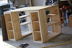 craft table with cubbies on the front for accessibility and shelves on the sides for storage