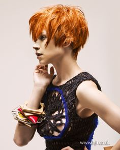 A bright red layered crop was prepped with texture spray and roughly blow-dried to enhance texture.