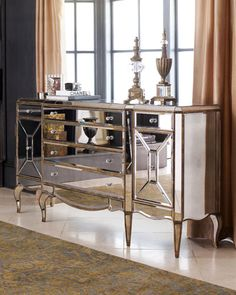 "Made of select hardwood solids with mirrored veneers. Painted silver and gold finish. Six drawers and two doors that conceal two adjustable shelves. 72""W x 19""D x 39""T. Imported. Boxed weight, approxi"