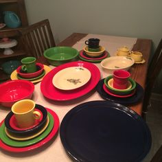 Cheerful Christmas fiesta ware: cobalt, scarlet, shamrock, and sunflower with Christmas tree serve ware on an ivory background