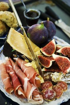 a beautiful antipasti spread of figs an meat, pour a glass of wine, tear off some ciabatta... and relax