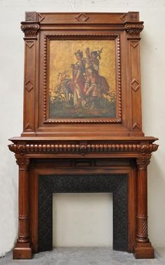 antique Napoleon III style fireplace made out of walnut wood, decorated with a painting on leather