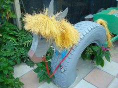 Playground horse made from recycled tire