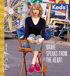 Taylor pairs red sneakers with red lipstick (her favourite colour), adding monochrome capri pants