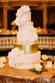5 tier wedding cake with white sugar roses and hand painted gold accents. | Amy Beck Cake Design, Chicago. Photograph courtesy of Katherine Salvatori photography