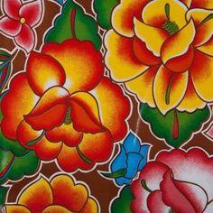 Mexicaans tafelzeil Tehuana Bruin - Mexicaans tafelzeil met gekleurde bloemen op een bruine ondergrond. Een fris dessin in de mooiste kleuren. Het tafelzeil van Kitsch kitchen is oerdegelijk en is dus ideaal geschikt om mee te knutselen. Maar natuurlijk ook perfect als tafelkleed op de keukentafel! Te bestellen vanaf 50 centimeter.
