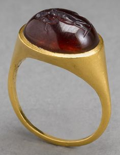 Jewelry Auction - Nov 30th 2016 - Hellenistic Greek gold ring with cabochon garnet intaglio of Aphrodite, nude, standing by a fountain and arranging her hair. Estimate: $15,000 - $18,500. This and more important ancient art for sale on CuratorsEye.com.