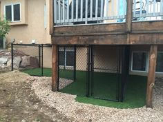 Dog Ramp - Our dogs den under the deck with dog turf. A ramp from the deck leading into the den is being constructed. There will also be a chain link top with optional waterproof canvas lid. Our little Toy Fox Terrier loves it!