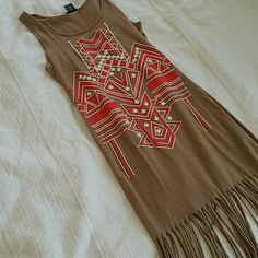 Aztec print fringe dress Aztec print fringe dress, nude color with print on the front midi dress on me about 5'1 tight fitting cute dress.  NWT Bundle and save 10%. Make and offer :) Dresses Midi