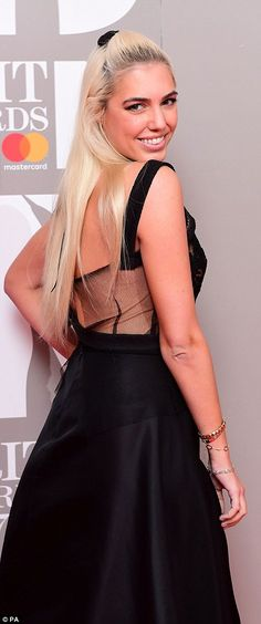 Glamorous: Amber Le Bon displayed her model credentials in a simple black dress with a she...