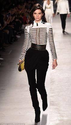 Thread tread: She's been making her mark on the fashion world in her own right - pictured in Balmain x H&M collection in October