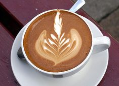 Presentation can be an integral part of coffeehouse service, as illustrated by the common rosetta design layered into this latte.