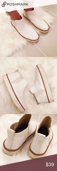➡️Zara White Leather High Top Sneakers⬅️ Gorgeous casual shoes! A few scuffs as shown and some marks that will wipe off. Elastic around the ankles and pull tab on the back. White leather with croc-like texture.  Offers welcome. Take 30% off your entire purchase automatically at checkout when you use the bundle feature, or ask me to create a custom bundle for you. Happy Poshing! Zara Shoes Sneakers